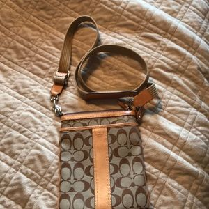 Tan fabric/leather trimmed coach crossbody